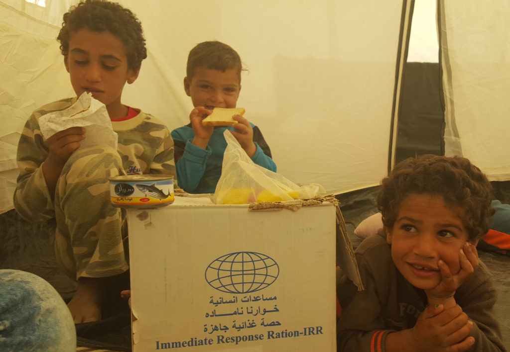 Hamood's children happy to receive an IRR package.