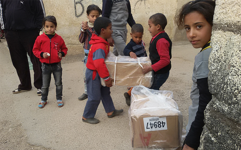 Syria Emergency Food Security Program - Children receiving food distribution