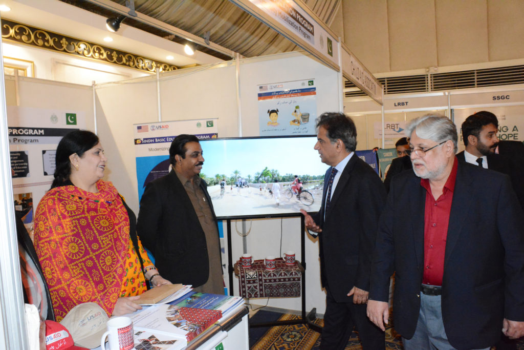 CMP staff briefing the summit participants who visited its stall at the event