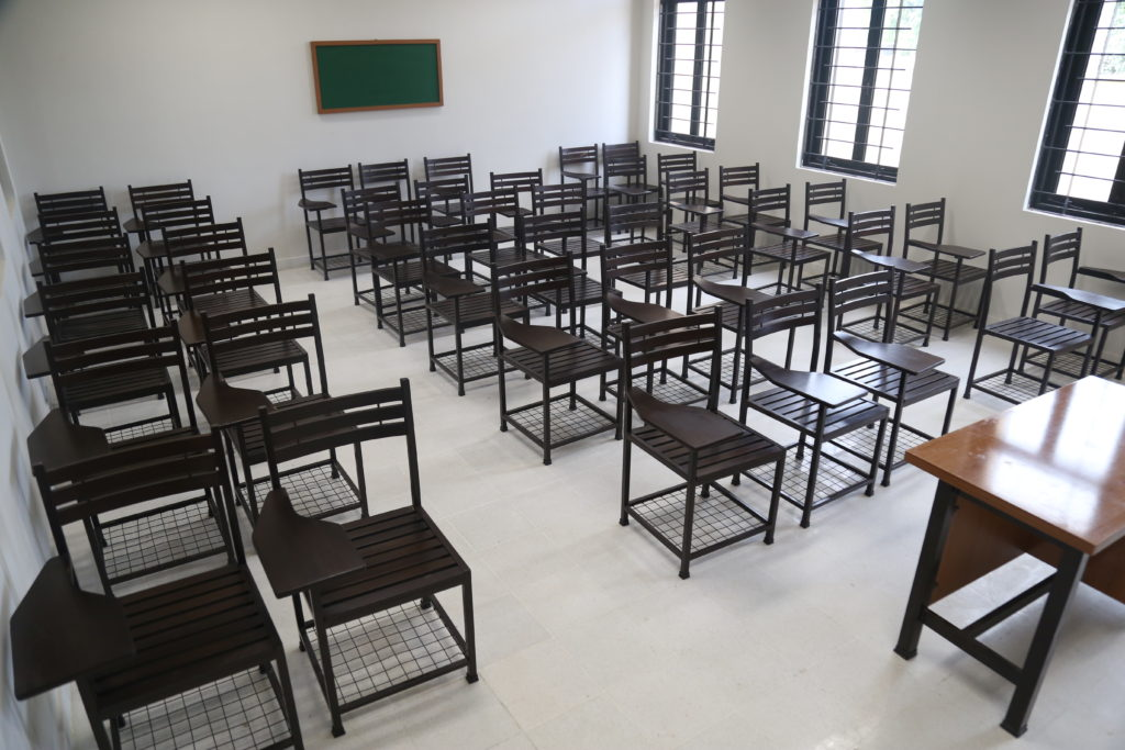 updated classroom with desks, chairs, and a blackboard
