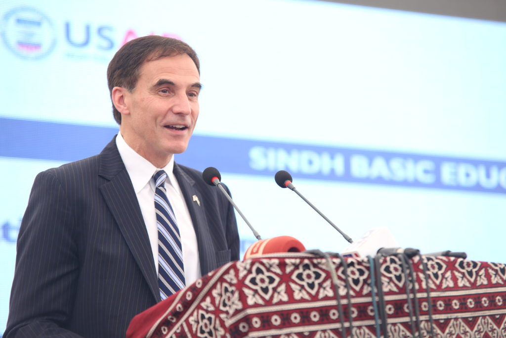 Mr. Jones, US Ambassador to Pakistan, addresses the crowd at the school inauguration in Damba Village, Karachi