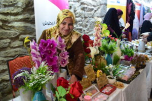 An artist displays her work at the Karak bazaars on November 28