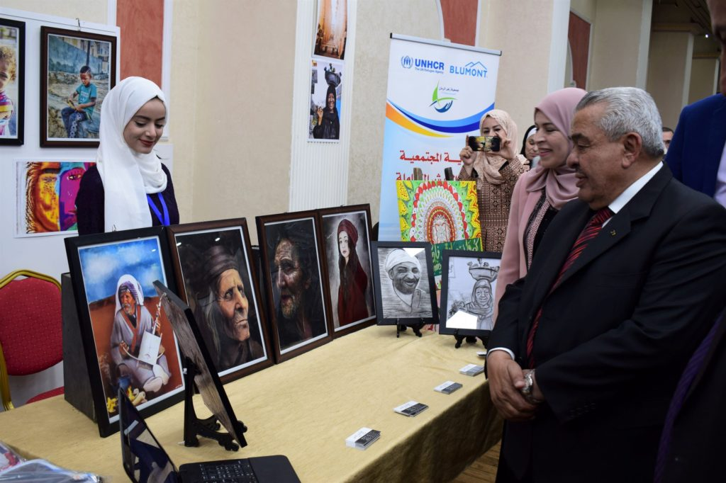 "An artist showcases her work at the ""Hands of Irbid"" bazaars"