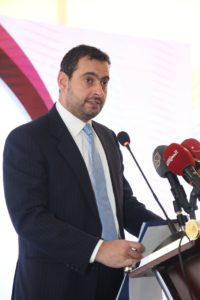 Dr. Tariq Mohammad Hammouri, Jordan's Minister of Industry, Trade, and Supply, gives opening remarks at the bazaar for home-based businesses
