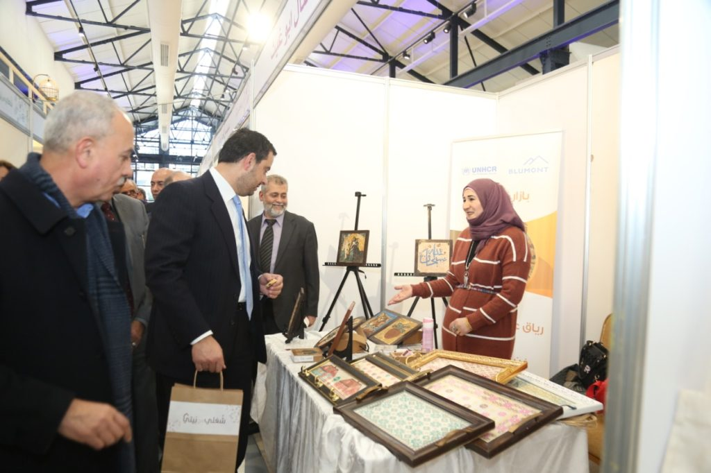 An HBB owner interacts with visitors at her stall at the bazaar for home-based businesses