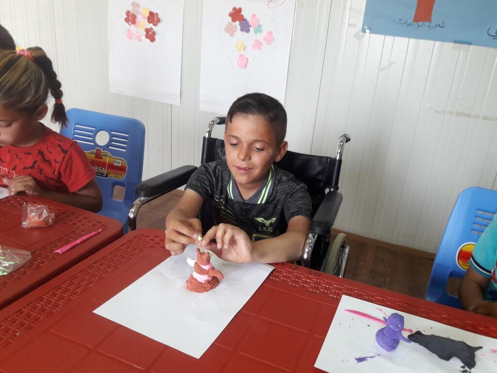 Syria_NES_SIS_USAID_Taha_PwDs_children_2020